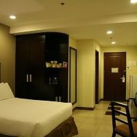 Udobna soba v hotelu Alpa City Suites v Cebu Cityju na Filipinih